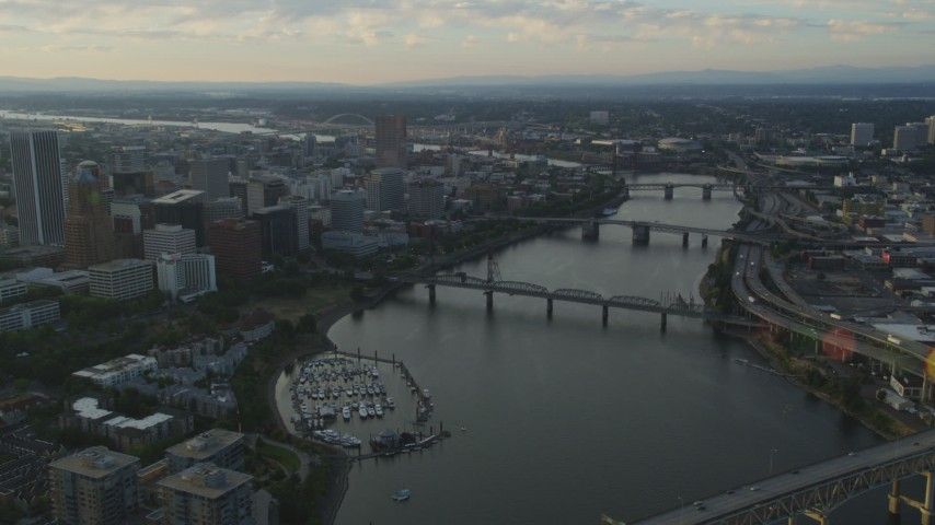 5K stock footage aerial video pass by Marquam Bridge, tilt to reveal Downtown Portland, Oregon, sunset Aerial Stock Footage | AX54_032