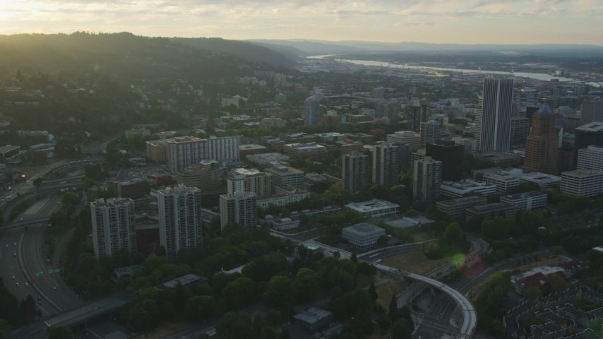 5K stock footage aerial video of panning across Downtown Portland cityscape, Oregon, sunset Aerial Stock Footage | AX54_033