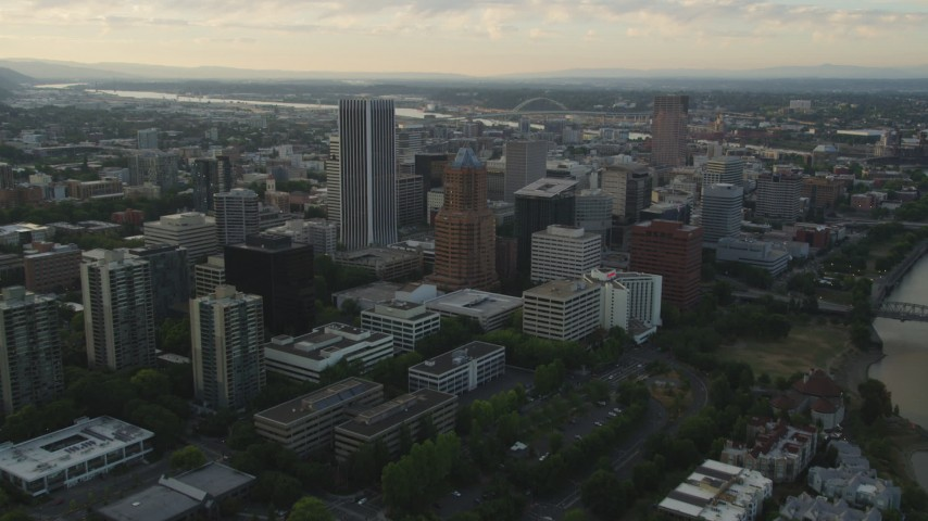 5K stock footage aerial video approach and fly over KOIN Center, Wells Fargo Center, Downtown Portland, Oregon, sunset Aerial Stock Footage | AX54_038