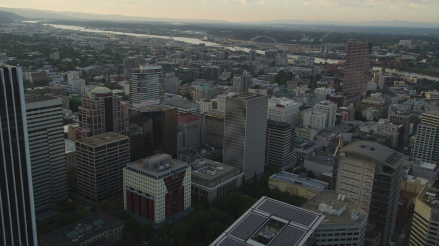 5K stock footage aerial video of flying over downtown, approaching Fremont Bridge, Downtown Portland, Oregon, sunset Aerial Stock Footage | AX54_039