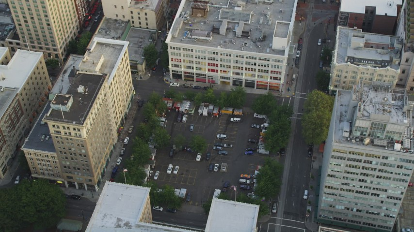 5K stock footage aerial video of orbiting a parking lot and office buildings, Downtown Portland, Oregon, sunset Aerial Stock Footage | AX54_040