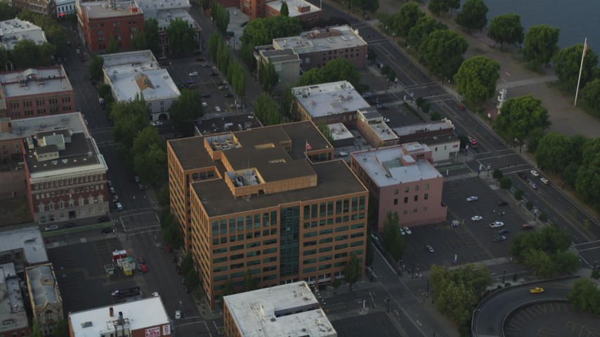 Flyby an office building on Downtown Portland, Oregon, sunset Aerial Stock Footage | AX54_043