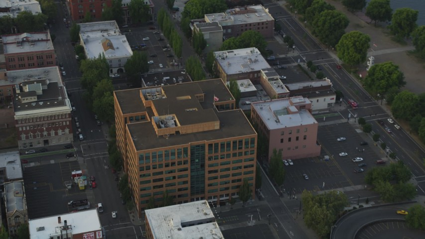 5K stock footage aerial video flyby an office building on Downtown Portland, Oregon, sunset Aerial Stock Footage | AX54_043