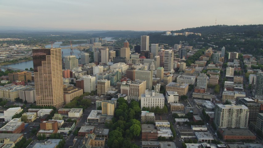 5K stock footage aerial video of flying by US Bancorp Tower, approaching Downtown Portland, Oregon, sunset Aerial Stock Footage | AX54_048