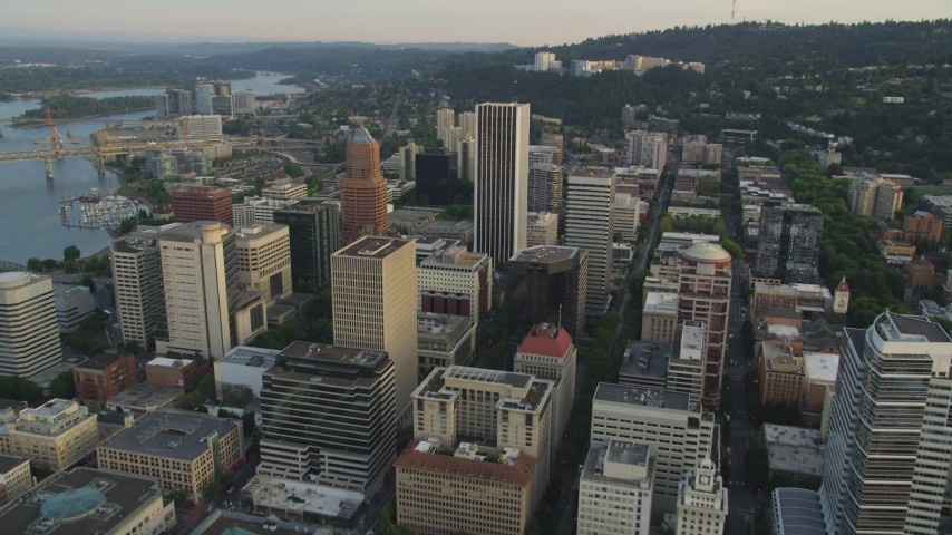 5K stock footage aerial video of approaching Oregon Science and Health University from Downtown Portland, Oregon, sunset Aerial Stock Footage | AX54_049