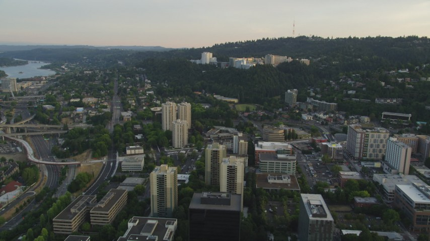 5K stock footage aerial video of approaching Oregon Health and Science University, Portland, Oregon, sunset Aerial Stock Footage | AX54_050