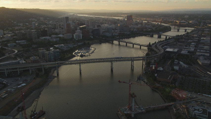 5K stock footage aerial video of approaching bridges and Downtown Portland, Oregon, sunset Aerial Stock Footage | AX54_056