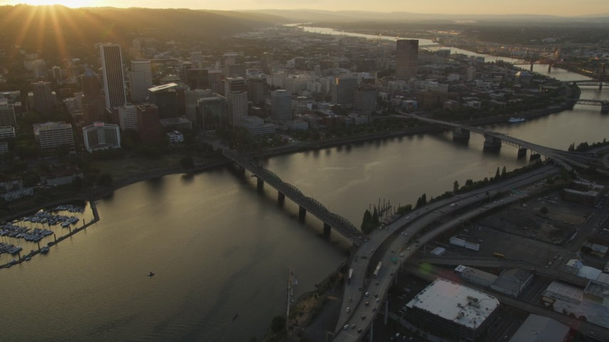 5K stock footage aerial video follow Hawthorne Bridge, Willamette River, Downtown Portland, Oregon, sunset Aerial Stock Footage | AX54_057