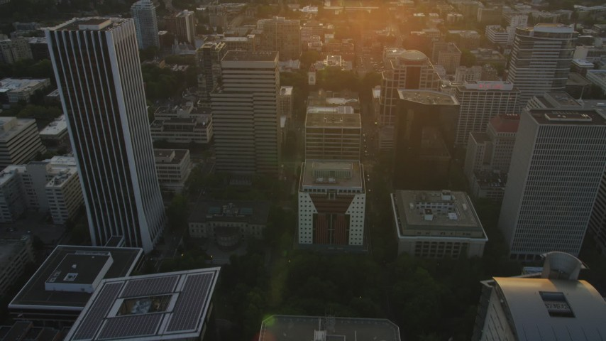 5K stock footage aerial video of following SW Madison Street near Wells Fargo Center, Downtown Portland, Oregon, sunset Aerial Stock Footage | AX54_058