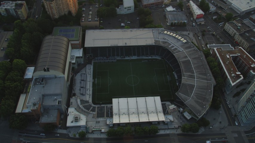 5K stock footage aerial video approach Providence Park, formerly Jeld-Wen Field, Downtown Portland, Oregon, sunset Aerial Stock Footage | AX54_059
