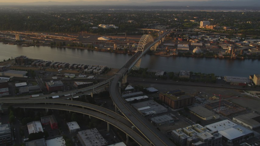 5K stock footage aerial video of approaching Fremont Bridge and freeway interchange, Downtown Portland, Oregon, sunset Aerial Stock Footage | AX54_061