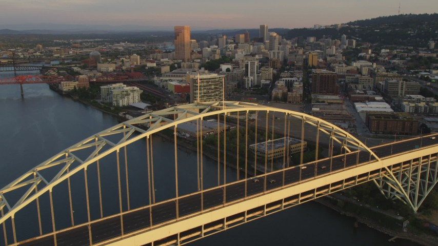 5K stock footage aerial video of orbiting Fremont Bridge, revealing Downtown Portland, Oregon, sunset Aerial Stock Footage | AX54_063