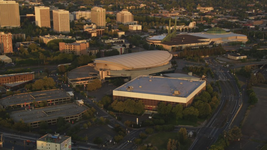 5K stock footage aerial video of Rose Garden Arena, Memorial Coliseum, Oregon Convention Center, Portland, Oregon, sunset Aerial Stock Footage | AX54_064