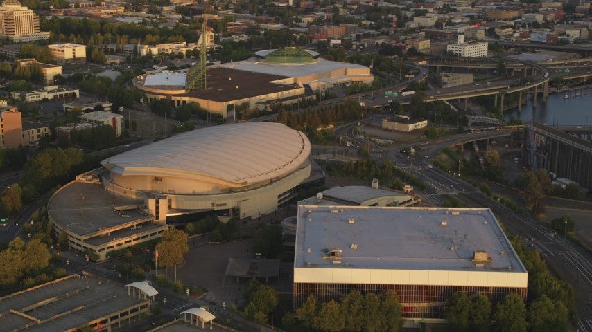 5K stock footage aerial video of Rose Garden Arena, Memorial Coliseum, Downtown Portland, Oregon, sunset Aerial Stock Footage | AX54_065