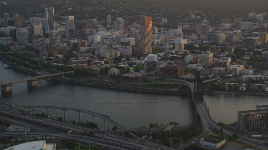 5K stock footage aerial video of flying by downtown, from near Steel Bridge, Downtown Portland, Oregon, sunset Aerial Stock Footage   AX54_066