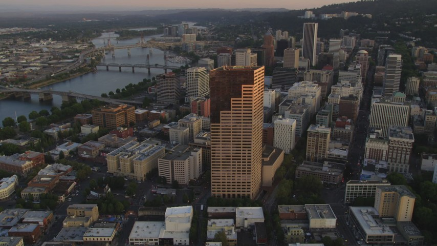 5K stock footage aerial video of approaching US Bancorp Tower and bridges over the Willamette River, Downtown Portland, Oregon, sunset Aerial Stock Footage | AX54_068