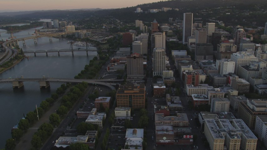 5K stock footage aerial video of panning across Willamette River and Downtown Portland, Oregon, sunset Aerial Stock Footage | AX54_069