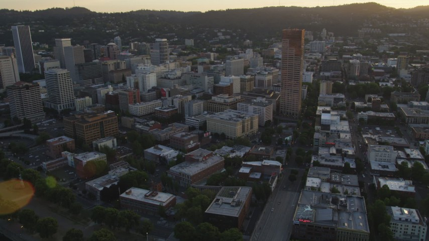 5K stock footage aerial video of approaching US Bancorp Tower, tilt down on hotel and neighboring buildings, Downtown Portland, Oregon, sunset Aerial Stock Footage | AX54_071