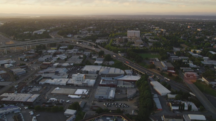 5K stock footage aerial video of Highway 30 / Interstate 5 interchange and warehouse buildings, North Portland, Oregon, sunset Aerial Stock Footage | AX54_073