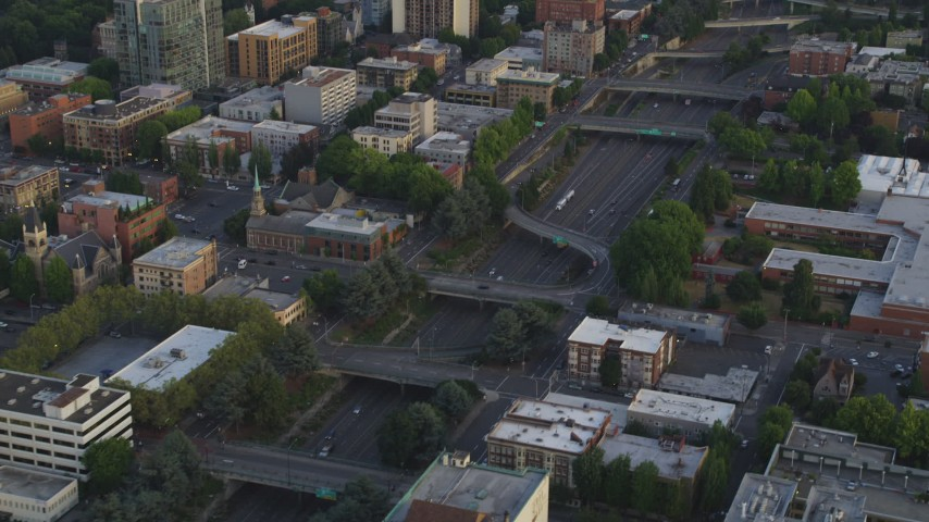 5K stock footage aerial video of flying by Interstate 405, Downtown Portland, Oregon, sunset Aerial Stock Footage | AX54_078