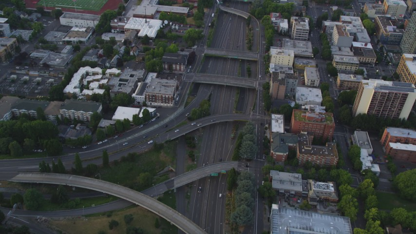 5K stock footage aerial video of bird's eye view following Interstate 405 through Downtown Portland, Oregon, sunset Aerial Stock Footage | AX54_080