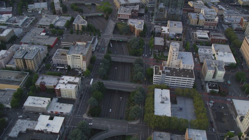 5K stock footage aerial video of bird's eye view of following Interstate 405, Downtown Portland, Oregon, sunset Aerial Stock Footage | AX54_081