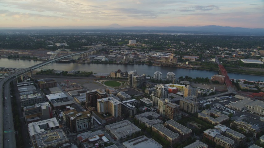 5K stock footage aerial video of approaching Fremont Bridge from Downtown Portland, Oregon, sunset Aerial Stock Footage | AX54_082