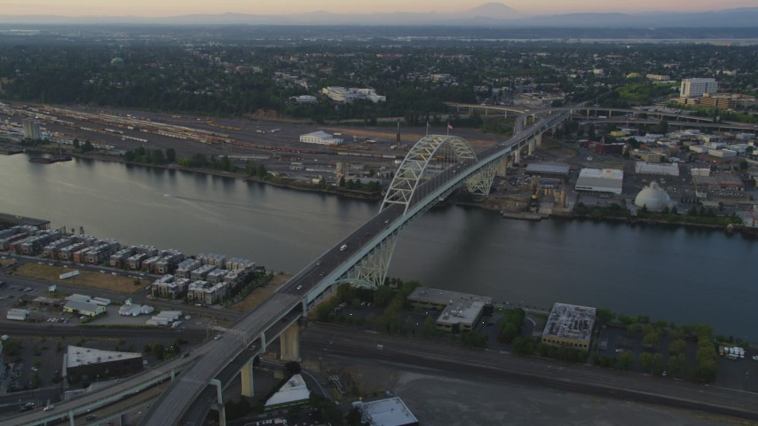 5K stock footage aerial video of orbiting the top of the Fremont Bridge, Downtown Portland, Oregon, sunset Aerial Stock Footage | AX54_083