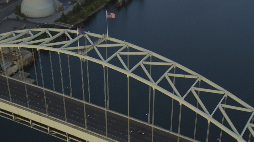 5K stock footage aerial video of tracking cars crossing the Fremont Bridge at sunset, Downtown Portland, Oregon Aerial Stock Footage AX54_084 | Axiom Images
