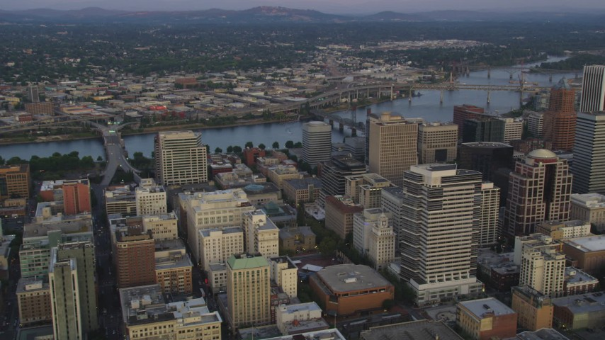5K stock footage aerial video fly over downtown, pan to KOIN Center and Wells Fargo Center, Downtown Portland, Oregon, sunset Aerial Stock Footage | AX54_087