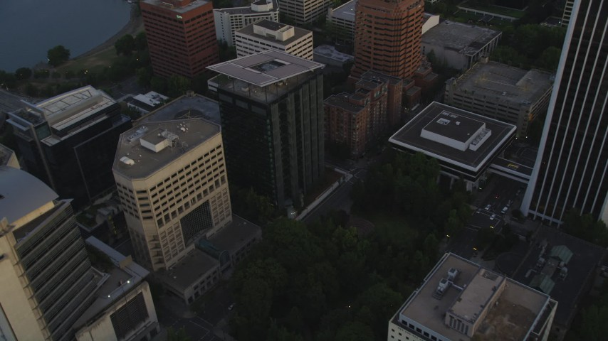 5K stock footage aerial video of approaching office building and Terry Schrunk Plaza and tilt down Downtown Portland, Oregon, sunset Aerial Stock Footage | AX54_088