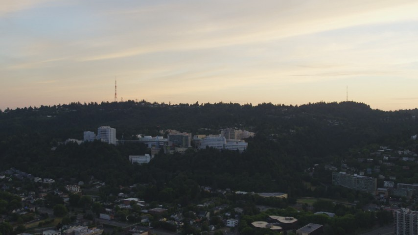 5K aerial video of approaching Oregon Health and Science University, Portland, Oregon, sunset Aerial Stock Footage | AX54_089