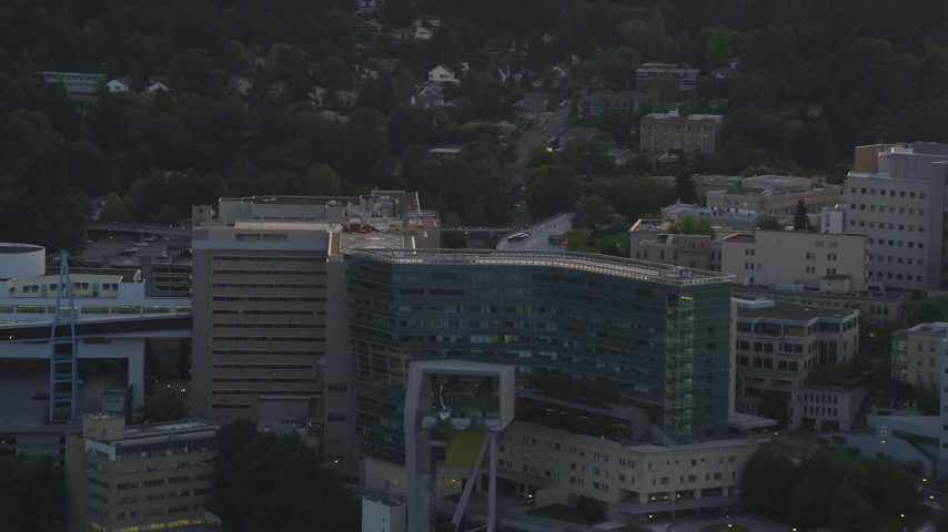 5K stock footage aerial video of helicopter landing, Oregon Health and Science University, Portland, Oregon, sunset Aerial Stock Footage | AX54_090