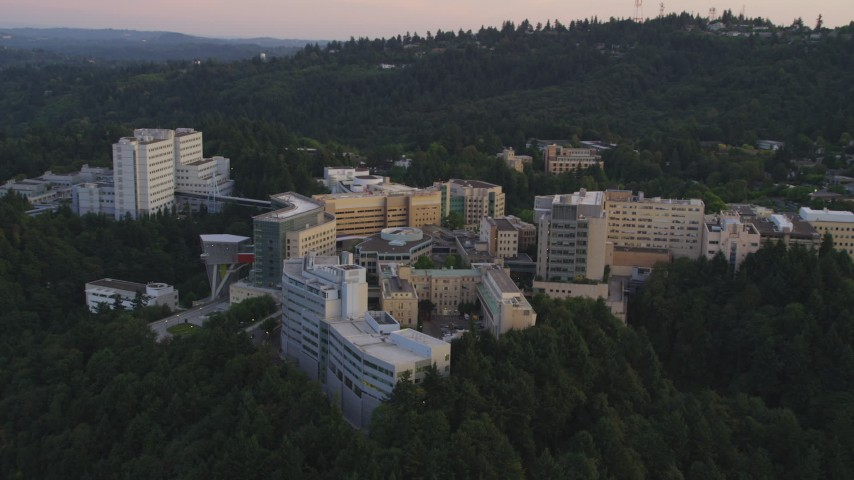 5K stock footage aerial video of flying away from Oregon Health and Science University, Portland, Oregon, twilight Aerial Stock Footage | AX54_093