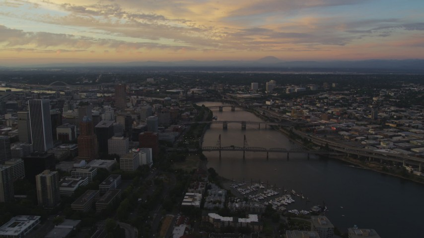 5K stock footage aerial video of approaching bridges spanning the Willamette River in Downtown Portland, Oregon, twilight Aerial Stock Footage | AX54_095