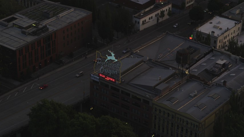 5K stock footage aerial video of tracking the White Stag Sign, Portland, Oregon, twilight Aerial Stock Footage | AX54_098
