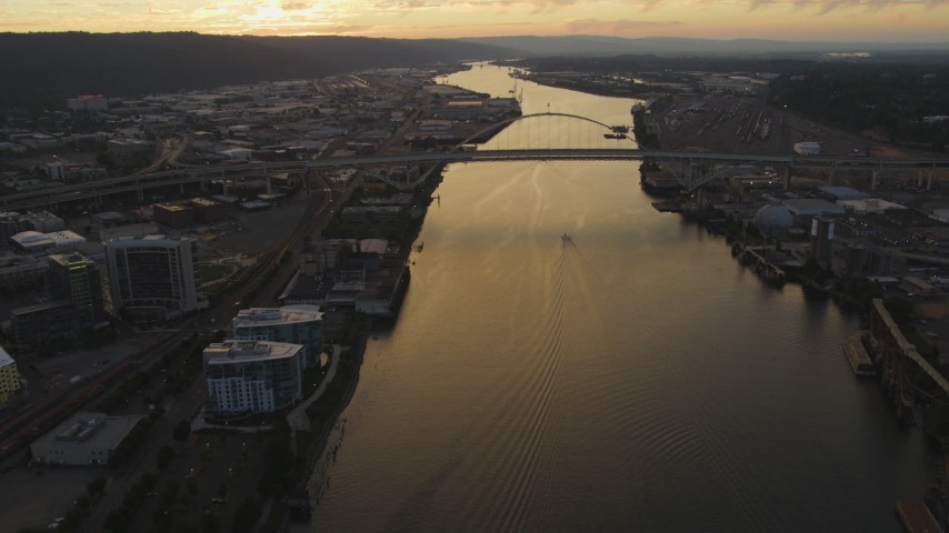 5K stock footage aerial video of approaching the Fremont Bridge, Willamette River, Downtown Portland, Oregon, twilight Aerial Stock Footage | AX54_099