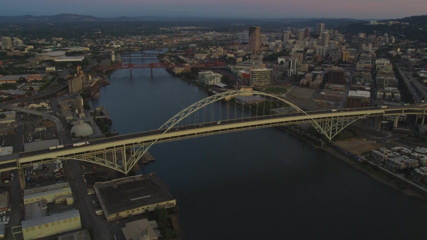 Pan across the Fremont Bridge, revealing Downtown Portland, Oregon, sunset Aerial Stock Footage | AX54_101