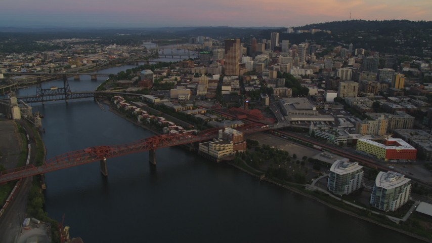 5K stock footage aerial video of flying by downtown and bridges over the river, Downtown Portland, Oregon, twilight Aerial Stock Footage | AX54_103