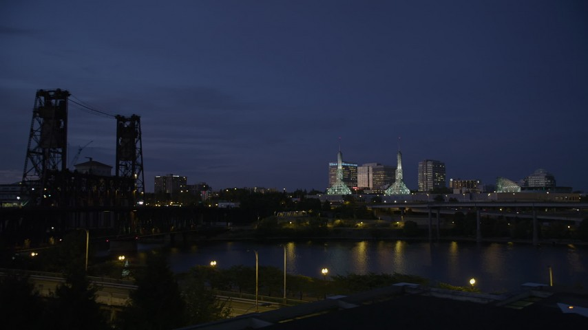 5K stock footage aerial video twin spires on Oregon Convention Center lit up at twilight, Lloyd District, Northeast Portland, Oregon Aerial Stock Footage | AX55_001