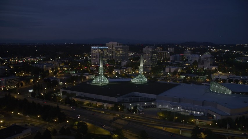 5K stock footage aerial video of approaching Oregon Convention Center and office buildings, Lloyd Center, Northeast Portland, Oregon, twilight Aerial Stock Footage | AX55_003