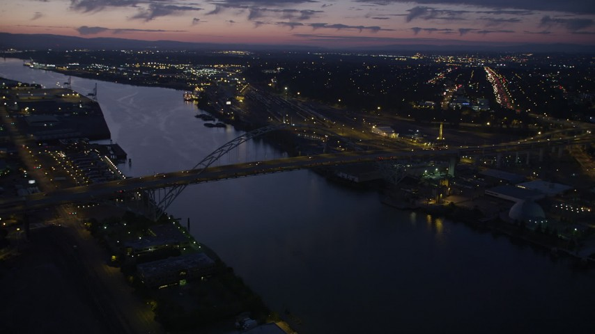 5K stock footage aerial video of flying by the Fremont Bridge, Downtown Portland, Oregon, twilight Aerial Stock Footage | AX55_005