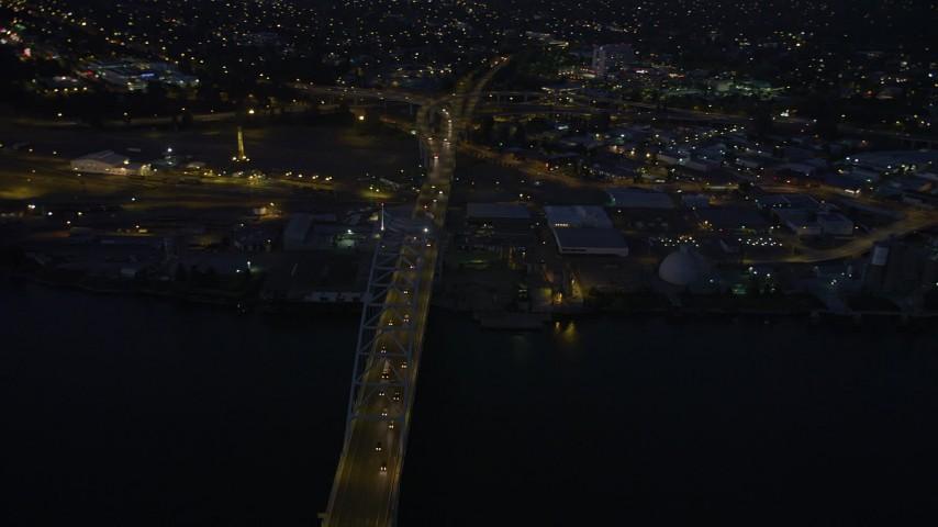 5K stock footage aerial video of orbiting the Fremont Bridge, Downtown Portland, Oregon, twilight Aerial Stock Footage | AX55_006