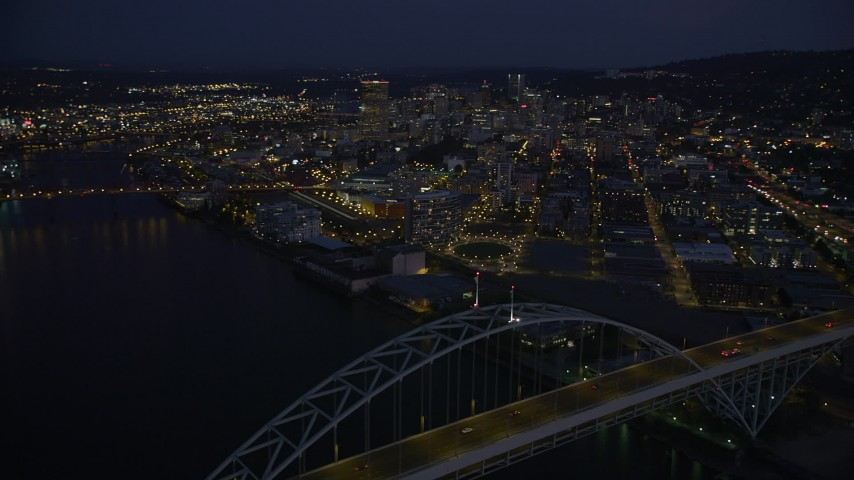5K stock footage aerial video of orbiting the Fremont Bridge, revealing Downtown Portland, Oregon, twilight Aerial Stock Footage | AX55_007