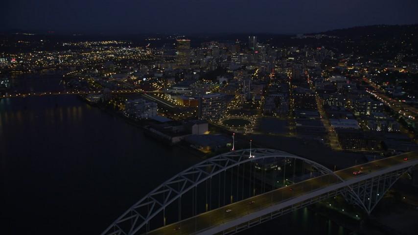 Orbiting the Fremont Bridge, revealing Downtown Portland, Oregon, night Aerial Stock Footage | AX55_007