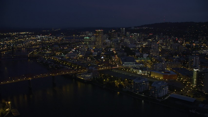 5K stock footage aerial video fly by Downtown Portland, over Broadway Bridge, Portland, Oregon, twilight Aerial Stock Footage | AX55_008
