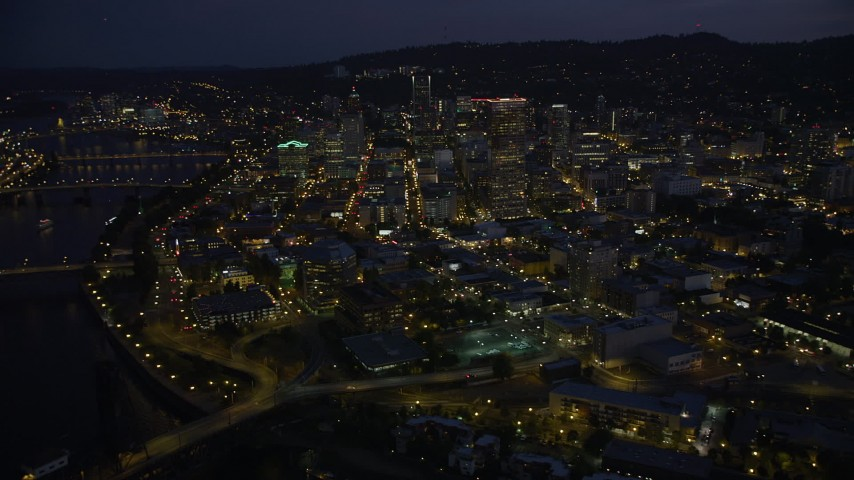 5K stock footage aerial video flyby skyscrapers in downtown, Steel and Burnside Street Bridges, Downtown Portland, Oregon, twilight Aerial Stock Footage | AX55_009