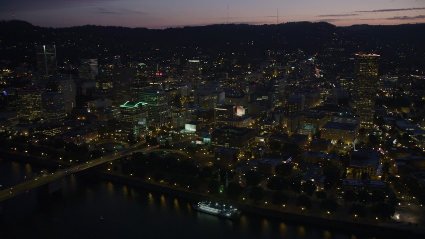 5K stock footage aerial video of fly by downtown, Burnside Street and Morrison Bridges, Downtown Portland, Oregon, twilight Aerial Stock Footage | AX55_010