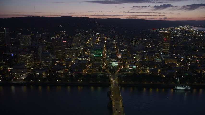 5K stock footage aerial video fly by buildings in downtown, Morrison and Hawthorne Bridges, Downtown Portland, Oregon, twilight Aerial Stock Footage | AX55_011