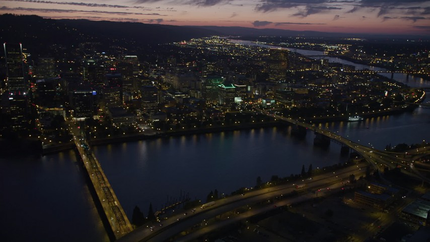 5K stock footage aerial video of flying by downtown, seen from Hawthorne Bridge, Downtown Portland, Oregon, twilight Aerial Stock Footage | AX55_012